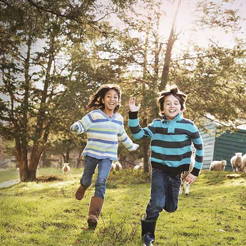 Kids happily running in a field